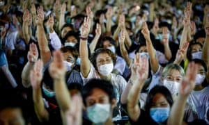 Pro-democracy demonstrators raise a three-finger salute – a gesture taken from film the Hunger Games – during a rally in Bangkok, Thailand, on Sunday.