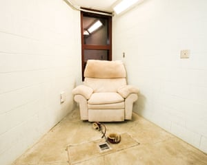 Compliant Detainee Media Room, Camp 5 by Debi Cornwall from her project 'Gitmo at Home, Gitmo at Play, Gitmo on Sale', which looks at the grim absurdity of daily life at the U.S. Naval Base at Guantánamo Bay. It focuses on images of the residential and leisure spaces of prisoners and military personnel as well as of Guantánamo Bay gift shop souvenirs.