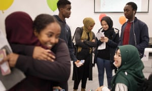 Students receive their results at Ark Academy in Wembley, London.