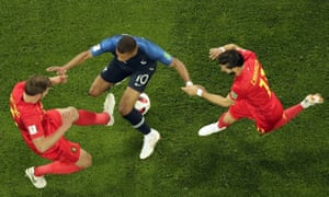Kylian Mbappé is challenged by Belgium's Jan Vertonghen (left) and Yannick Carrasco.