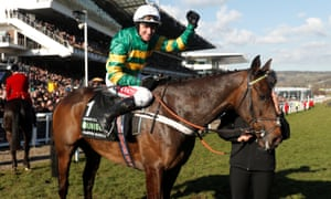 Barry Geraghty celebrates on Buveur D'Air after winning the Champion Hurdle.