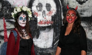 Tomb ravers … partygoers at last year's Kataloween, with a macabre mockup of the Mona Lisa.