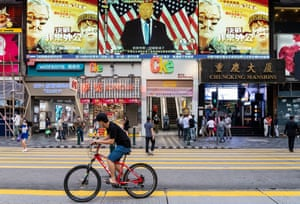 Hong Kong, China. Donald Trump is projected on a large screen in a street
