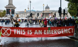 Extinction rebellion climate change protesters close roads in Westminster.