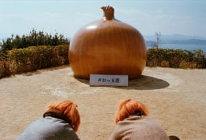 "The Little Onions by Artyt Lerdrakmongkol (second place, single)""This photo was taken while I was on vacation in Japan with my family in March 2017. Awaji Island is famous for having the sweetest onions in Japan. I like how the colour of the clear blue sky contrasts with the orange onion, and the mysterious orange hair of the girls."""