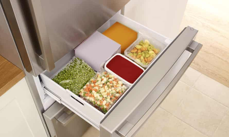 open full fridge drawer with frozen food