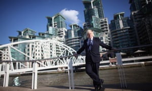 London's mayor, Boris Johnson, opening a river pier at the St George Wharf luxury flats. More than 90,000 UK properties are listed under overseas owners.