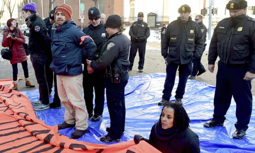John Lugo, of Unidad Latina en Accion of New Haven, is arrested during a demonstration on Friday in favor of changing the name of Yale University's Calhoun College.