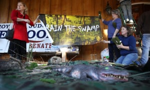 A 'swamp' display with toy alligators, snakes and other creatures at Moore's campaign rally in Midland City.