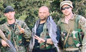 Joe Robinson (right) with other foreign fighters in Tal Abyad, Syria.