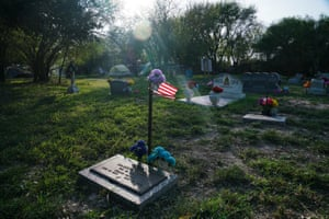 The Eli Jackson Cemetery which is located a few yards away south of the levee where Trump's border wall could be built as seen on Monday 2019 near Pharr, Tex.