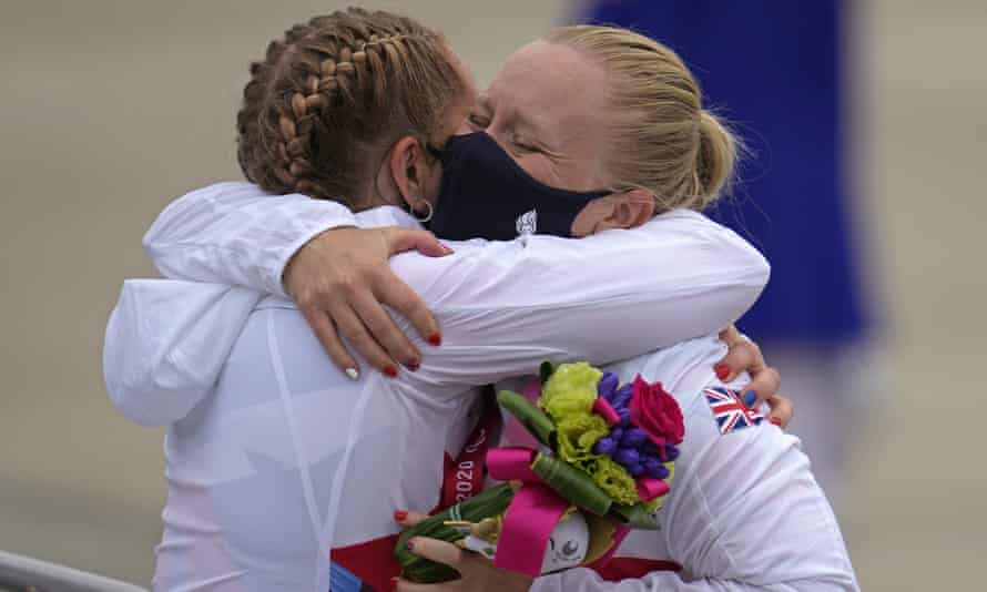 Britain's Laura Sugar, right, hugs compatriot and fellow gold medallist Charlotte Henshaw after both earned paracanoeing glory.