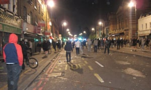 People gather in the streets during the Tottenham riots in 2011