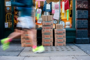 An early morning jogger running past Gardners paper bag shop in Spitalfields