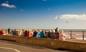 Seagulls circle in search of food dropped by visitors on the promenade at Sidmouth in Devon. But now deliberate feeding can result in an £80 fine.