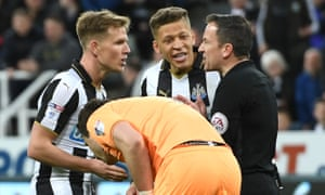 Matt Ritchie and Dwight Gayle protest to the referee Keith Stroud after having a penalty kick disallowed for encroachment