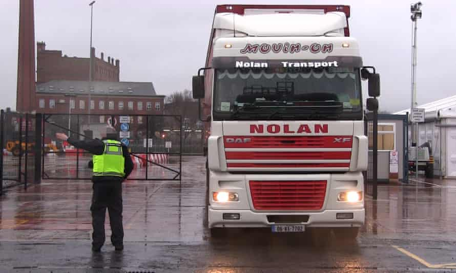 Border Force officers talk to a lorry driver at a checking facility near Belfast port.