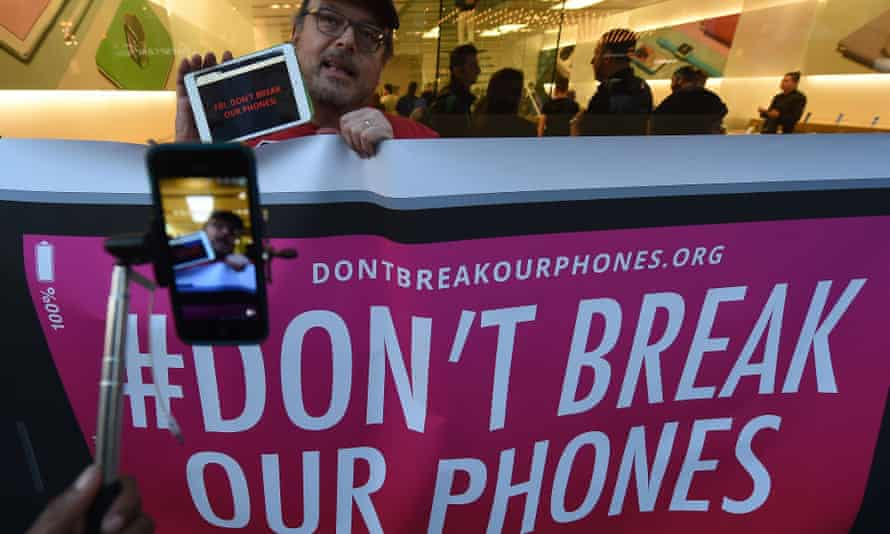 Protesters demonstrate against the US Government's attempt to put a backdoor to hack into the Apple iPhone, in Los Angeles, California on 23 February 2016.