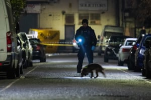 London, UK. Police search for evidence at the scene of a multiple stabbing in Seven Kings, Ilford. Three men were killed in the incident in north-east London