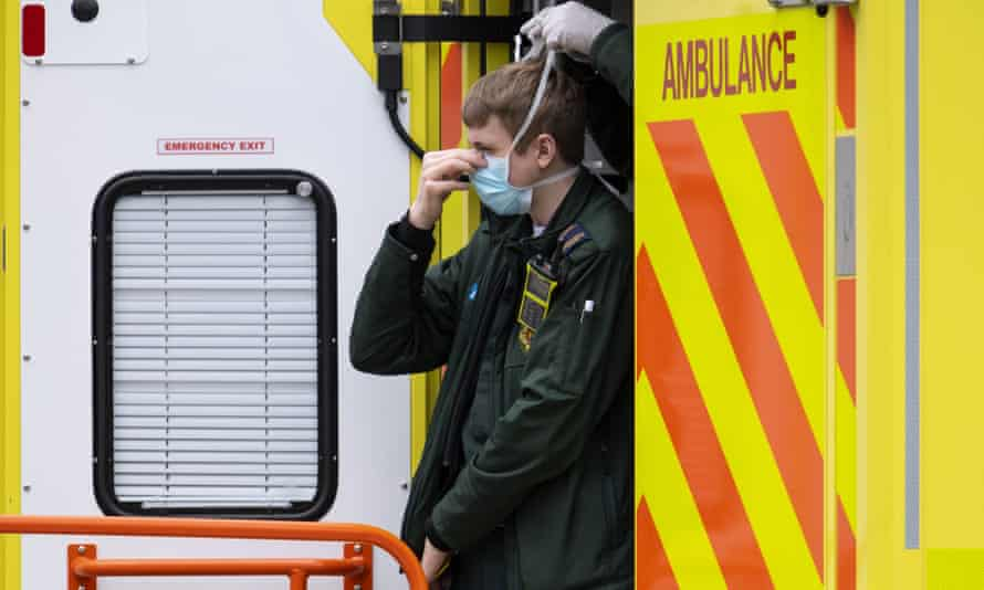 An NHS worker wearing a face mask.