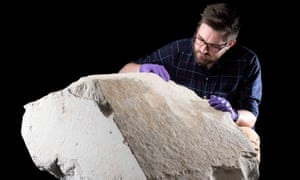 Dr Daniel Potter with the casing stone