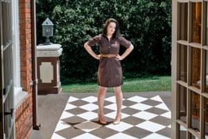 Mary Anna King standing in an open door