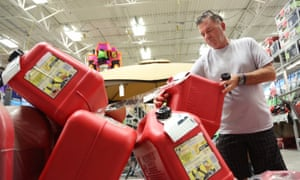Jim LaFeir, of Fort Lauderdale, buys a gas can at Lowe's on Tuesday in preparation for Hurrican Matthew.