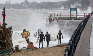 Surfers enter the rough seas at New Brighton, Wirral, during the week.