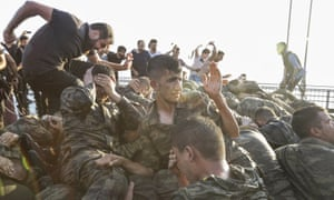 Angry civilians set upon soldiers involved in the coup attempt after they surrendered on the Bosphorus bridge