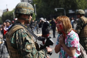 A demonstrator and a soldier in Santiago