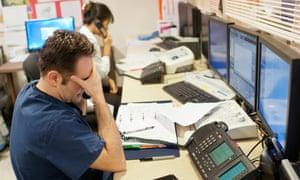 Stressed doctor talks on telephone