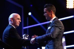 Cristiano Ronaldo accepts the best FIFA men's player award.