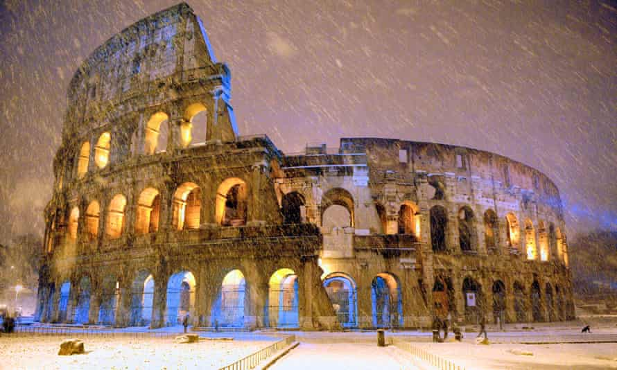 Snowfall at the Colosseum.