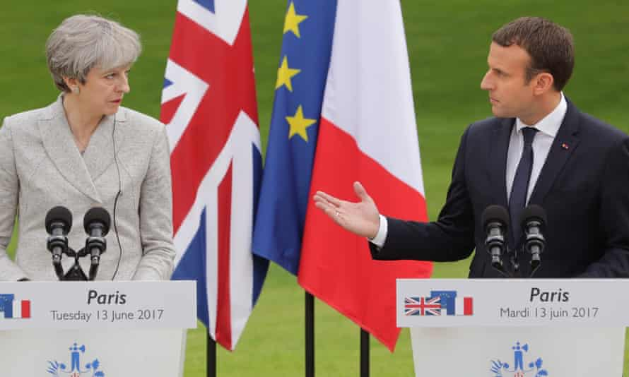 Theresa May and Emmanuel Macron in Paris on 13 June.