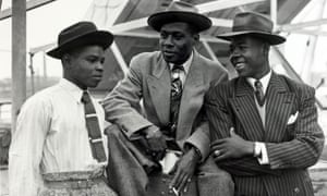 Some of the first immigrants from Jamaica arrive at Tilbury, London, onboard the Empire Windrush.
