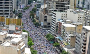 Anti-government protesters throng the streets of Caracas demanding a recall referendum for the president.