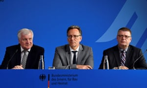 Horst Seehofer, left, Holger Münch, centre, and Thomas Haldenwang speak at a press conference on the murder of Walter Lübcke