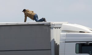 A man tries to board a UK-bound lorry at Calais.