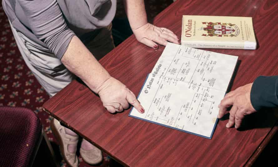 Attendees examine a branch of the Nolan family tree during the gathering.