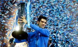 Novak Djokovic lifts the trophy after winning the ATP World Tour finals title for the fourth straight year.