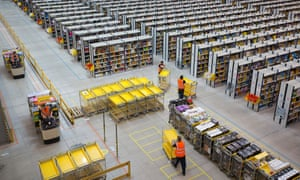 Operations At An Amazon.com Inc. Fulfillment Centre And An Argos Distribution Warehouse On Cyber Monday. Employees push empty carts as they prepare to process customer orders ahead of shipping at one of Amazon.com Inc.'s fulfillment centers in Rugeley, U.K., on Monday, Dec. 2, 2013.