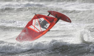 A windsurfer makes the most of the rough seas off of Bracklesham Bay in West Sussex, as Storm Erik brought strong winds