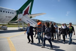 """A group of 12 Syrian refugees board their plane with the pope. Pope Francis told migrants on Lesbos they were """"not alone"""""""