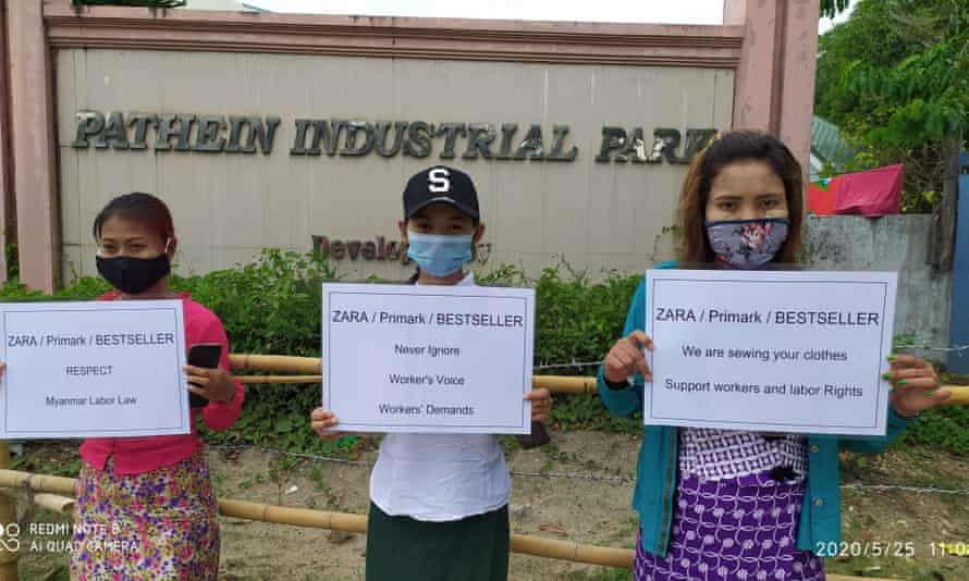 Workers outside Huabo Times factory in Pathein, Myanmar, send messages to brands.