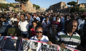 People take to the streets in support of refugees during a rally staged by the 'Movements for Home' in Rome last month.