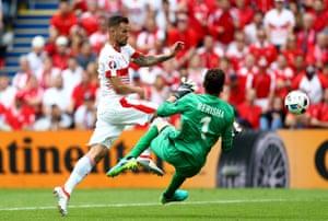 Etrit Berisha flies into Haris Seferovic.