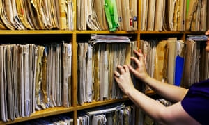 A GP searching patient health records. The speaker has granted a Commons urgent question about Guardian revelations about more than 500,000 pieces of patient data going undelivered.