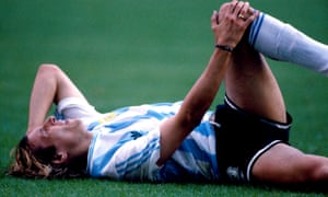 Claudio Caniggia of Argentina feels the pain after being felled by the crunching 'truck' tackle of Cameroon's Benjamin Massing.
