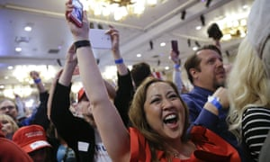 Supporters cheer during a caucus night rally for Donald Trump in Las Vegas.