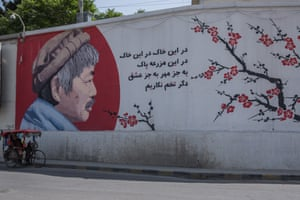 "A mural of a Japanese aid worker, Tetsu Nakamura, who was killed by gunmen in the eastern city of Jalalabad in December. ""Let's not plant anything but the seed of love and friendship in this pure land,"" a line next to his painted profile reads."